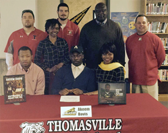 Akeem Davis signs to play football at App St.